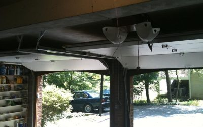 Garage Door Maintenance For $85.0 per door Call today
